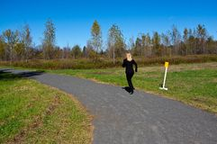Woman jogging in a park Royalty Free Stock Photos
