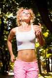 Woman jogging in the park - morning run Royalty Free Stock Images