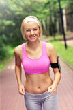 Woman jogging in the park Stock Photos