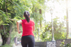 Woman jogging at the park Royalty Free Stock Photo