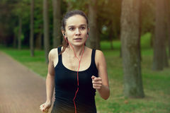 Woman jogging at park Royalty Free Stock Image