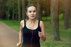 Woman jogging at park royalty free stock image