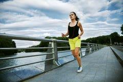 Woman jogging at park stock photography