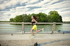 Woman jogging at park Royalty Free Stock Images