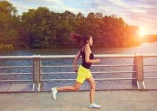 Woman jogging at park royalty free stock images