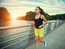 Woman jogging at park Stock Images