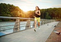 Woman jogging at park stock photos