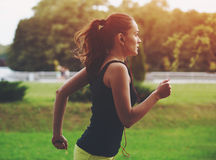 Woman jogging at park stock photo