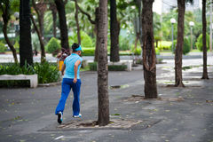 Woman jogging in park, Saigon Royalty Free Stock Image