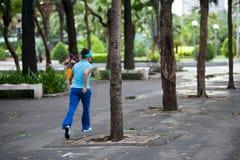 Woman jogging in park, Saigon Royalty Free Stock Image