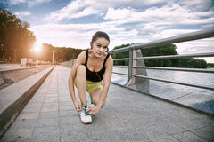 Woman jogging at park stock image