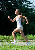 Woman jogging in the park in summer royalty free stock photography