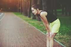 Woman jogging at park Stock Photos