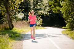 Woman jogging in park Royalty Free Stock Image