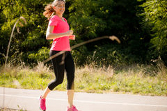 Woman jogging in park Stock Photography