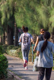 Woman jogging run in a outdoor park for exercise Royalty Free Stock Images