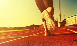 Woman jogging on a running track Royalty Free Stock Photo