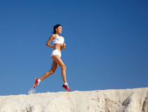 Woman jogging on sand Royalty Free Stock Image