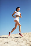 Woman jogging on sand Royalty Free Stock Images