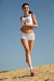 Woman jogging on sand Stock Image