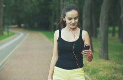 Woman jogging with smartphone royalty free stock images