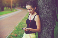 Woman jogging with smartphone Royalty Free Stock Image