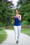 Woman jogging royalty free stock photography