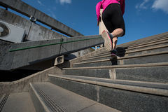 Woman jogging on  steps Stock Images
