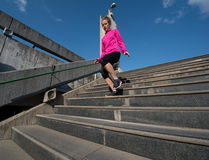 Woman jogging on  steps Royalty Free Stock Image