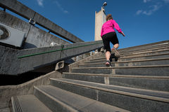 Woman jogging on steps. Sporty women running onsteps at early morning jogging stock images
