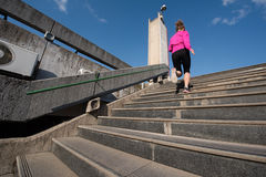 Woman jogging on  steps Stock Photography