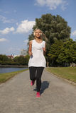 Woman jogging in summer Royalty Free Stock Images