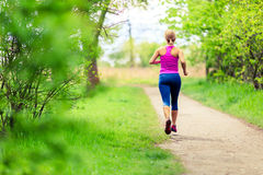 Woman jogging in summer park Stock Image
