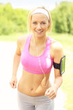Woman jogging on the sunny day Royalty Free Stock Image