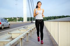Woman jogging to stay fit stock photography