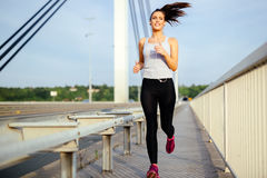 Woman jogging to stay fit stock image