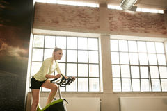 Woman jogging on treadmill Royalty Free Stock Image