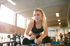 Woman jogging on treadmill Stock Images