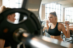 Woman jogging on treadmill Royalty Free Stock Photo