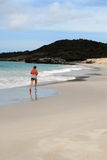 Woman jogging on white beach Stock Photography