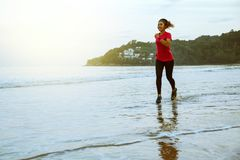 Free Woman Jogging Workout On The Beach In The Morning. Relax With The Sea Walk Royalty Free Stock Photo - 146541355