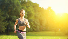 Woman jogs runs on nature Royalty Free Stock Images