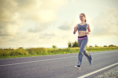 Woman jogs runs on nature Royalty Free Stock Image