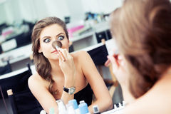 Woman joking in front of a mirror Stock Photography