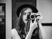 Woman journalist shoot. Photography camera Royalty Free Stock Images