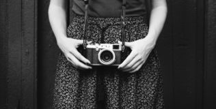 Monochrome Photo of Person Holding Vintage Camera stock image