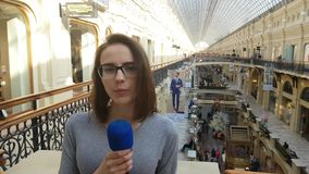 Woman Journalist And Tv Presenter Speaks Into A Microphone. APR 15, 2018 MOSCOW, RUSSIA: Woman Journalist And Tv Presenter Speaks Into A Microphone in Moscow stock video