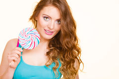 Woman joyful girl with lollipop candy Royalty Free Stock Photography