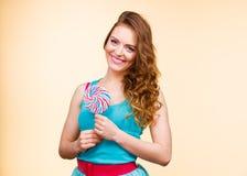 Woman joyful girl with lollipop candy Royalty Free Stock Photos