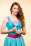 Woman joyful girl with lollipop candy Stock Photography
